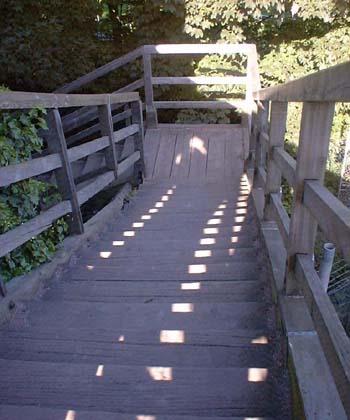 Wooden footbridge construction going down
