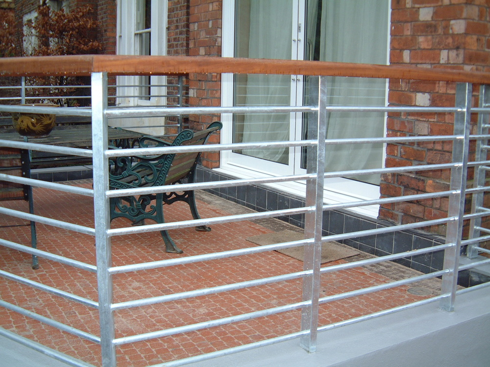 Steel rail with wooden handrail