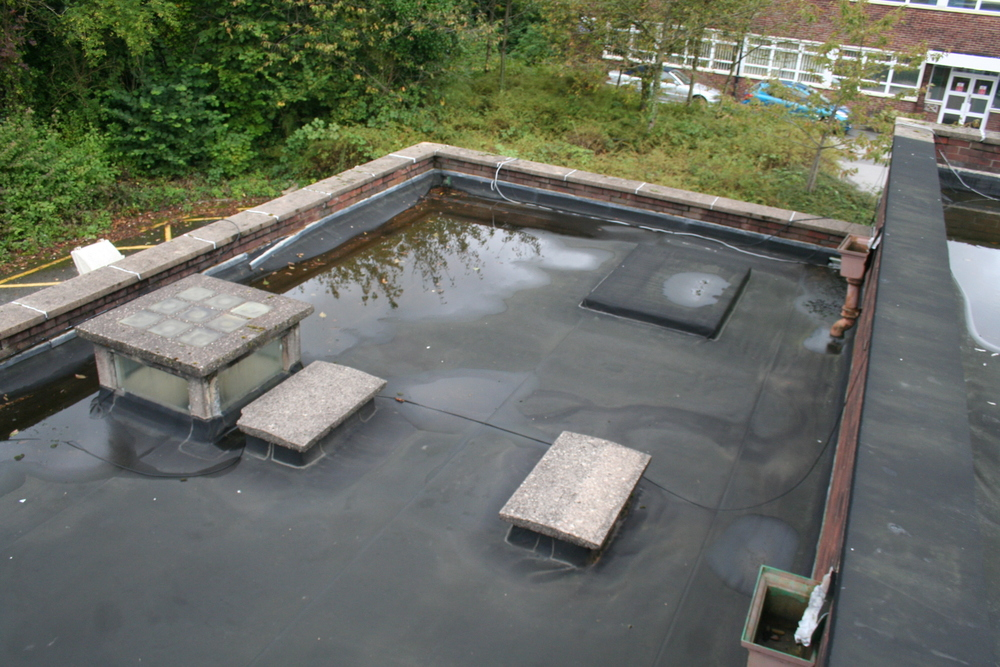 Flat roof construction and refurbish