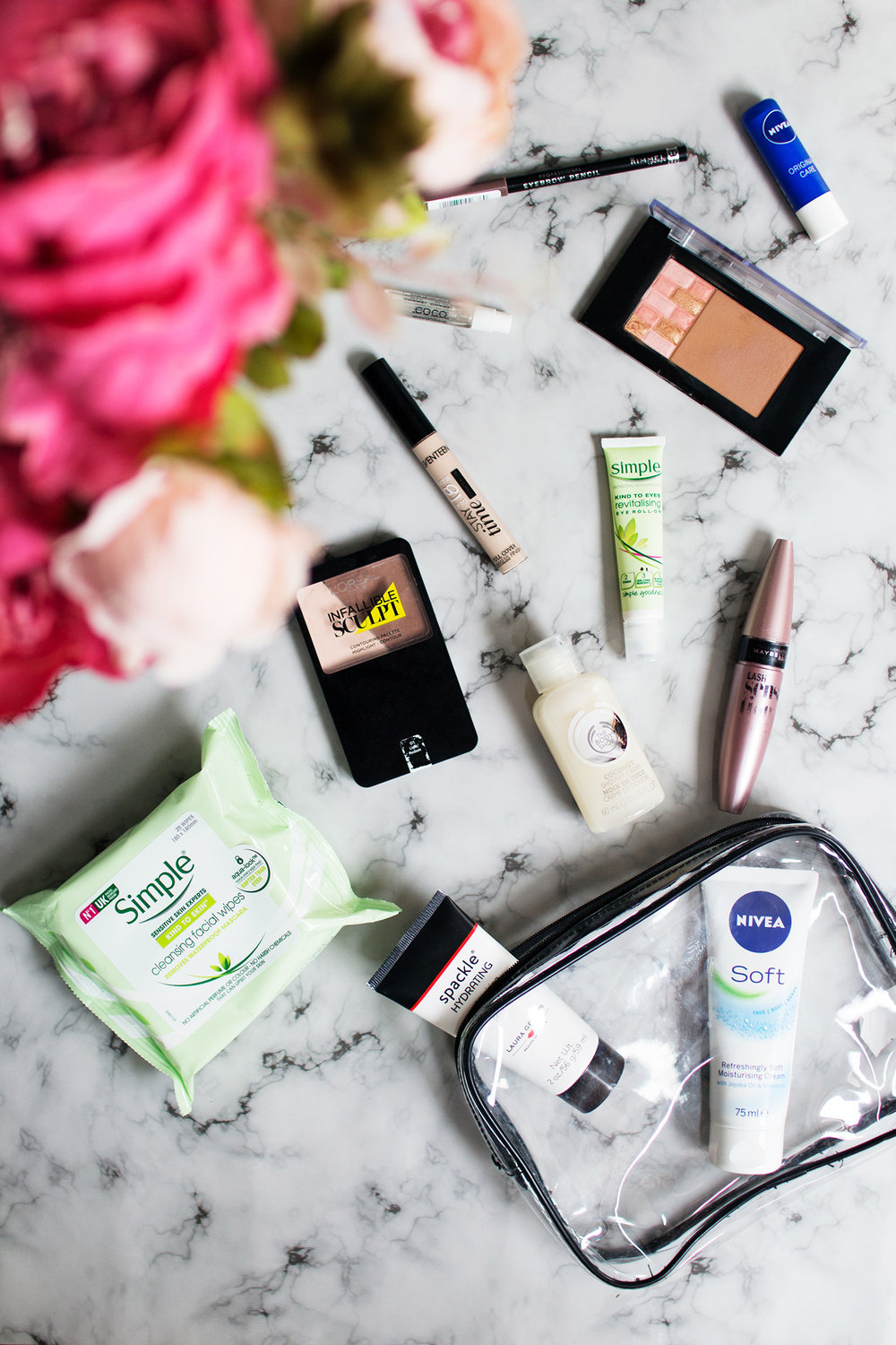Image of makeup and skincare flatlay on marble