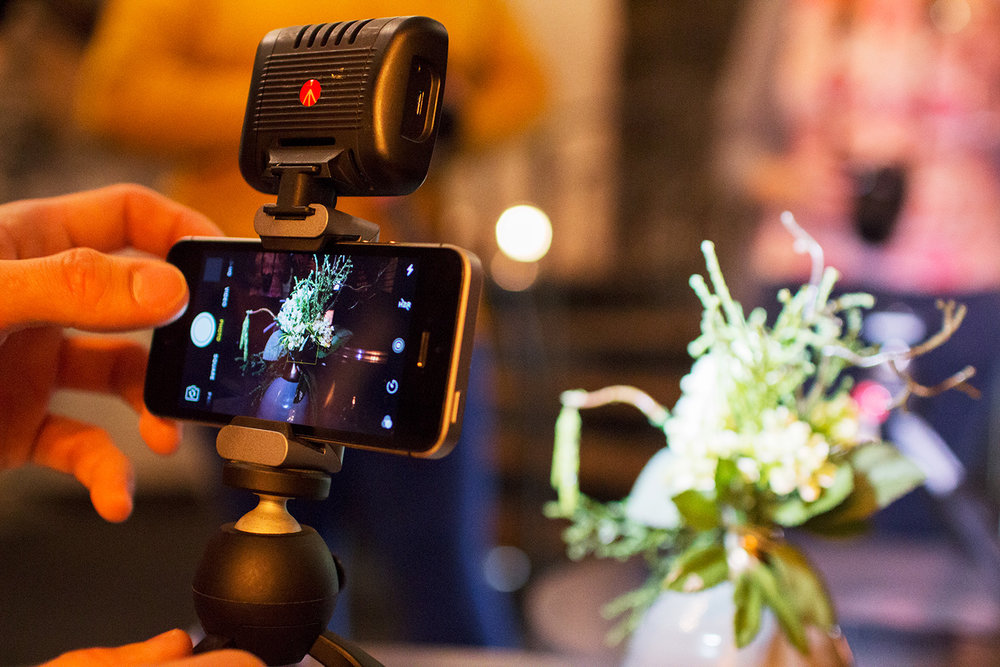 Manfrotto Mini Tripod with Universal Smartphone Clamp with an iPhone.