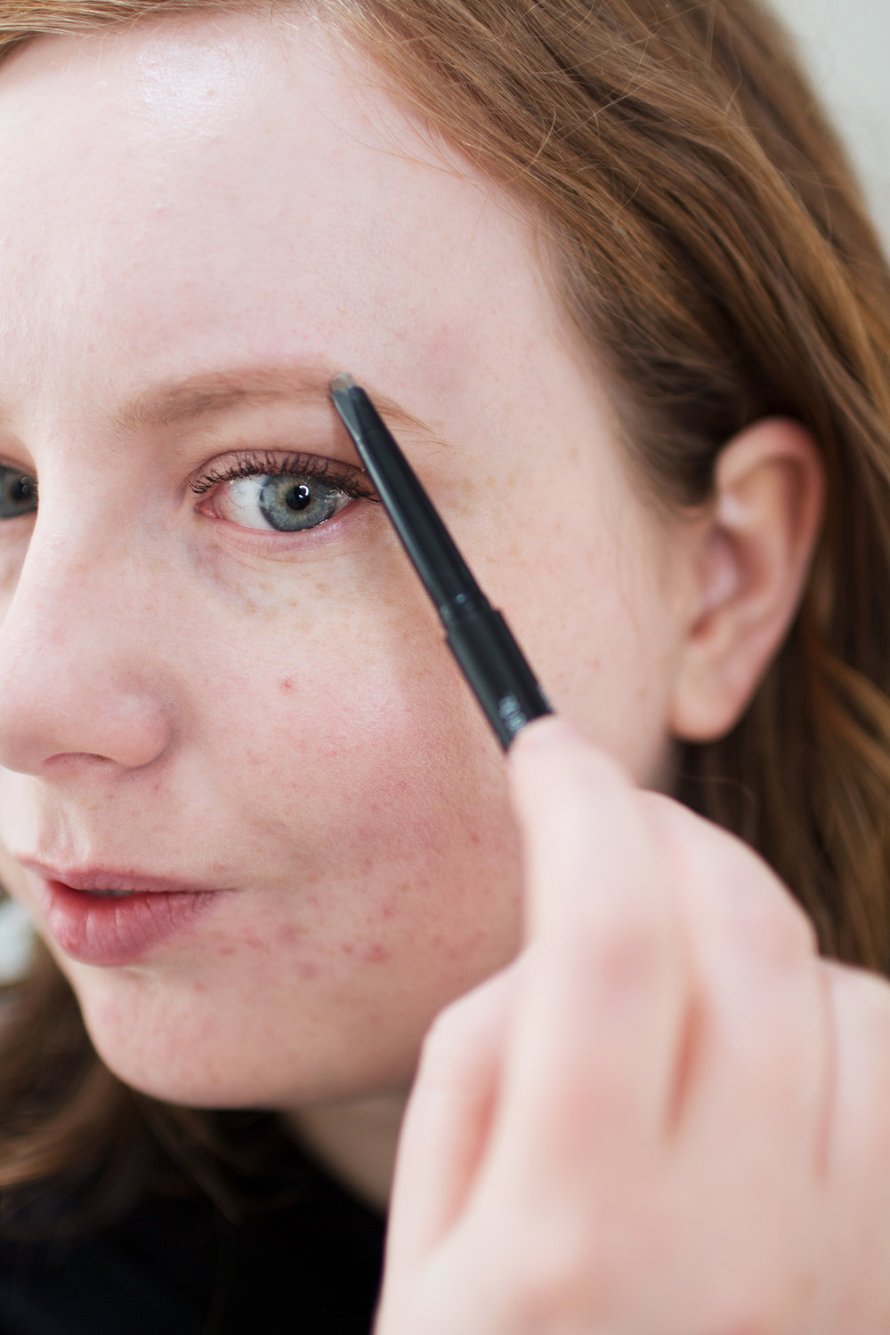 Alice Red, using the CYO Brow Sculpting Pencil.