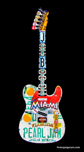 License plate guitar art combines client's passion for Pearl Jam and the FL Marlins.