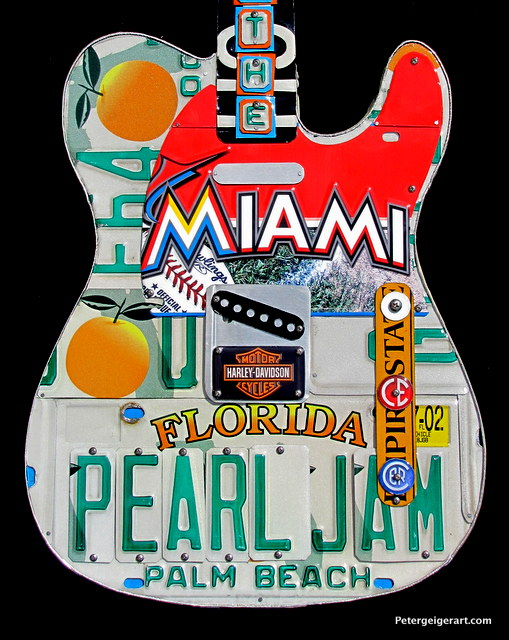 The decorative Miami piece is offset by the FL plates on this license plate guitar art.