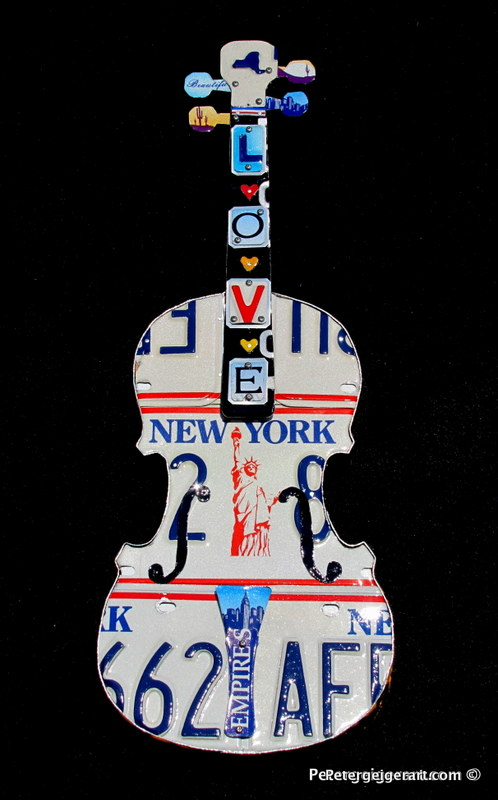 This one is personal. I was given a violin by my 92-year-old mother in law, who used it as a child. I used it to create this piece out of New York license plates, where she lived most of her life. It is proudly displayed in her apartment.