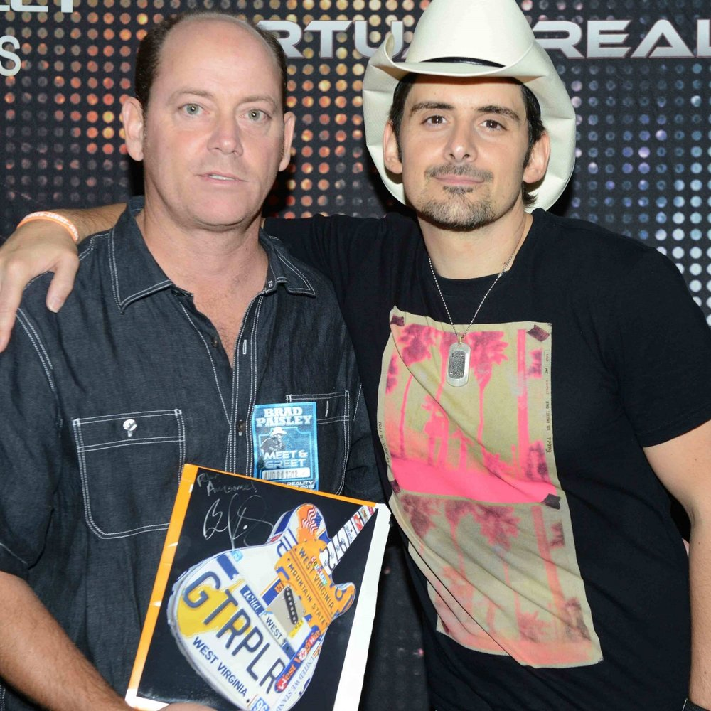 Pete Geiger created the custom license plate guitar art for Brad Paisley with Paisley's personal tags.