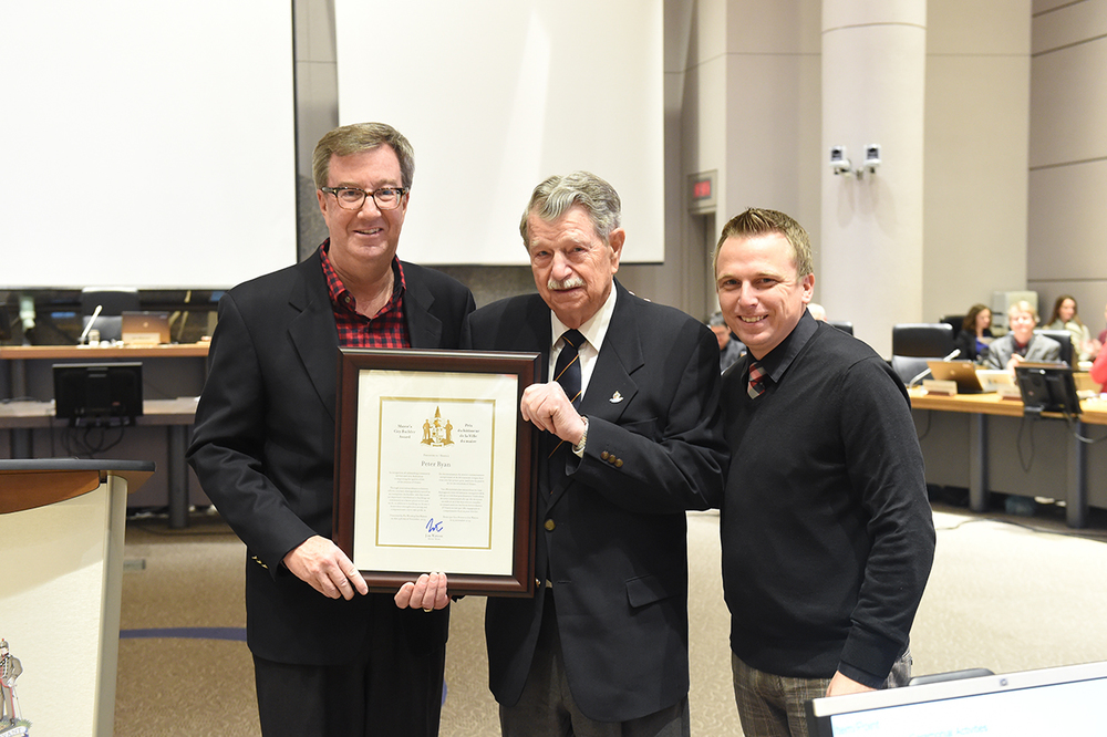 Rideau-Goulbourn resident, Peter Ryan, receiving Mayor Jim Watson's City Builder Award with Councillor Moffatt at November 25, 2015 Council Meeting.