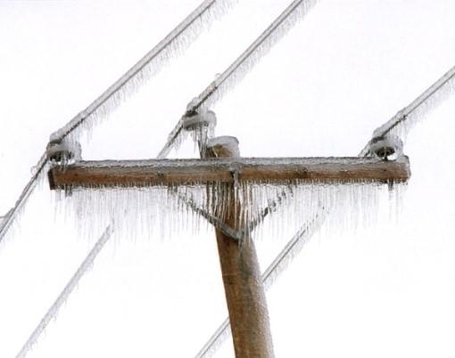 Ice sheathed hydro pole – Photo: National Defence