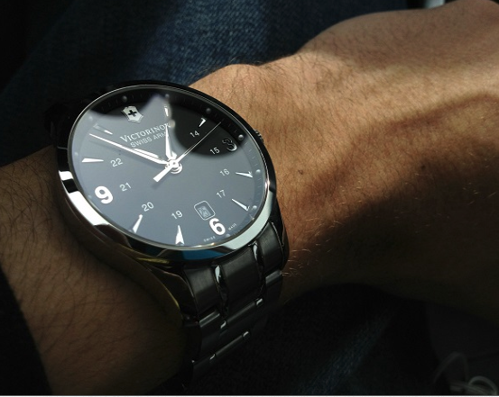 Image of a man wearing a black Victorinox Swiss Army Watch