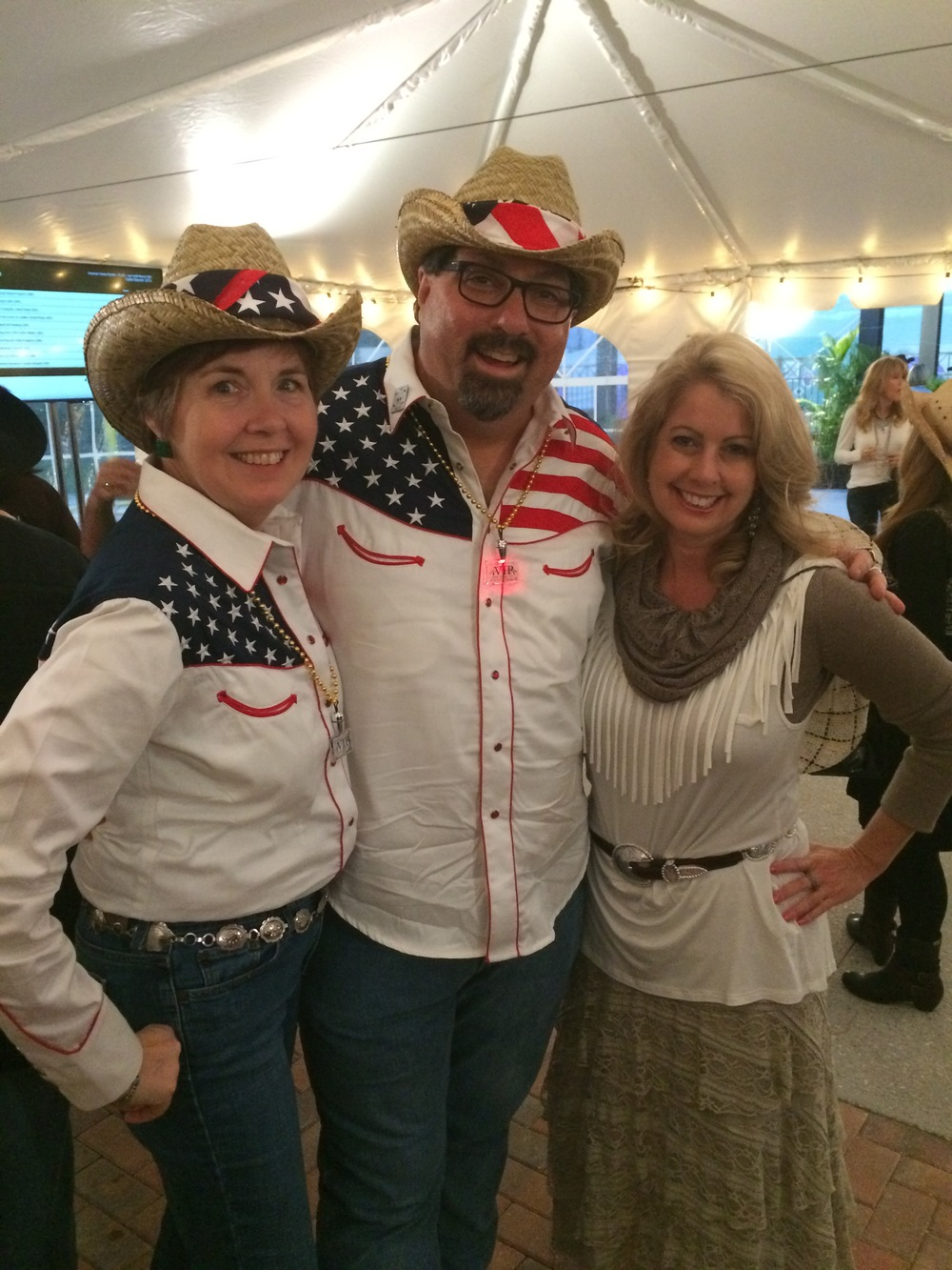 the-brilliants-kellie-and-bryon-mccartney-with-julie-harmon-at-the-cattle-barons-ball-2015.jpg