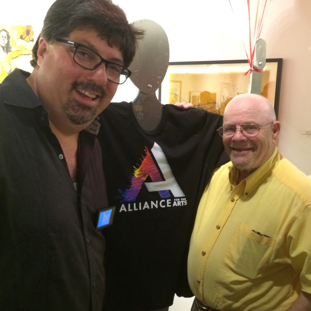 Bryon McCartney, creative director of Brilliant Lens and designer of the new Alliance logo, poses with Bill Waites who oversaw the design of the original Alliance logo.