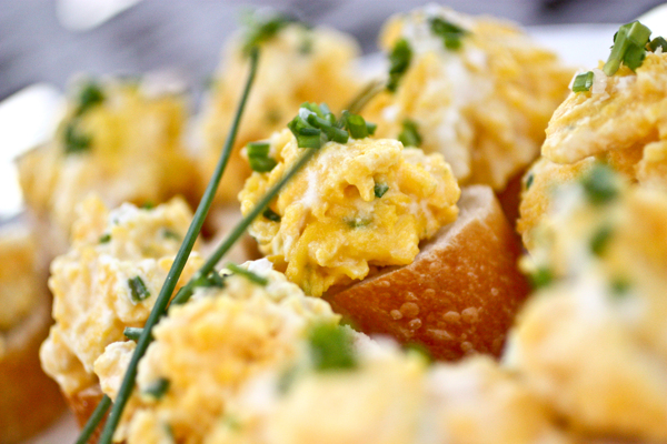 soft-scrambled eggs with ricotta cheese and chives on sourdoughbaguette.