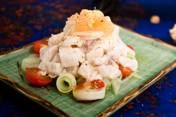 grapefruit tilapia ceviche with cherry tomatoes and cucumber curls.