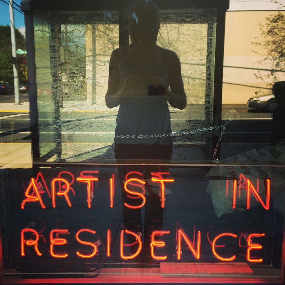The sign comes along with me when I am the artist in residence someplace else. This is at Weird Shift Storefront in North Portland, July 2014.