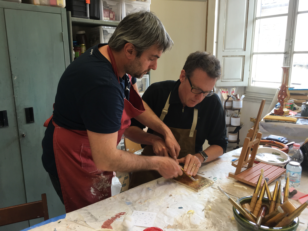 Emiliano guiding me on the best way to hold the agate burnisher. Photo credit:Alison Woolley.