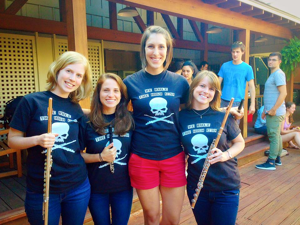 "The 2015 TMCO Flutes and our crafty tshirts with flute skulls and ""We Rule The High C's"" Fun group of incredibly talented and caring musicians. From the left: Johanna Gruskin, Blair Francis, Catherine Baker, Kelly Zimba"