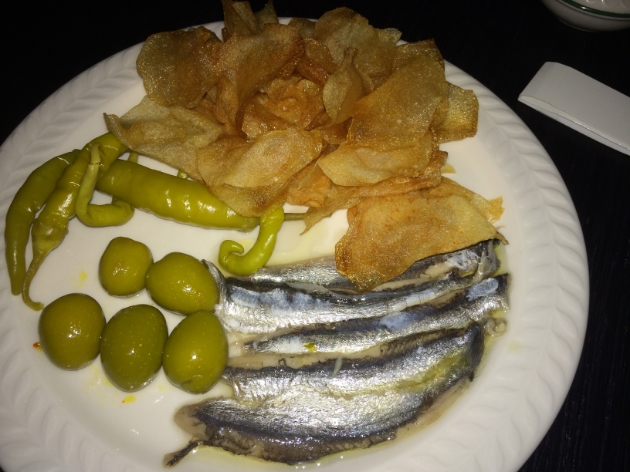 White anchovies. pickled peppers, chips.