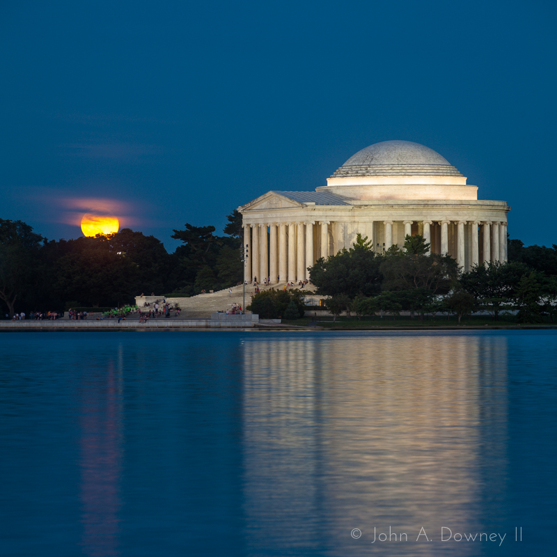 A glowing super moon breaks the treeline beyond the Jefferson Memorial on the National Mall, 2013.