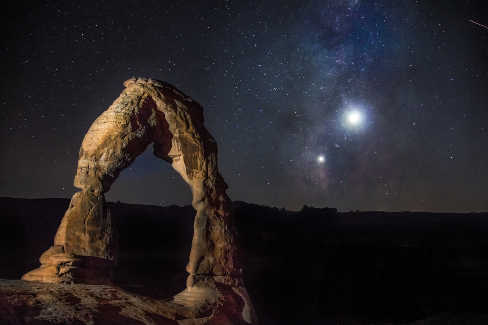 This isn't a sight you see every day!  The Delicate Arch and the stars in Arches National Park in Moab, Utah.  Image here.
