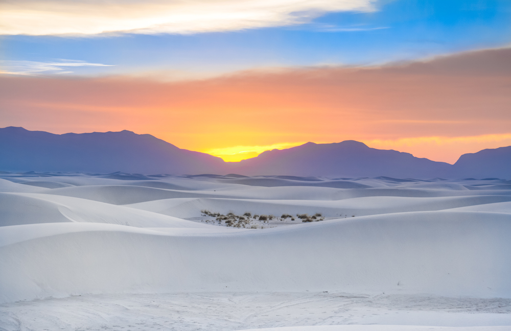 The sun sets over the gypsum dunes at White Sands National Monument, New Mexico.