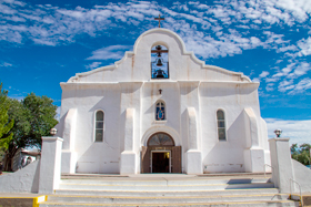 The beautiful white adobe exterior of the Presidio Chapel in San Elizario is an iconic fixture of the famous Mission Trail.