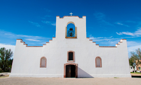 The facade of the Socorro Mission gives the illusion of a prop but walking through the doors reveals the depth and length of this old mission church.