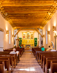 The Socorro Mission church attracts visitors with its golden altar and wooden structures.