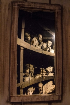 A haunting life-sized picture of victims in Europe's many concentration camps during World War II is placed behind a model camp, giving it a life-like quality.