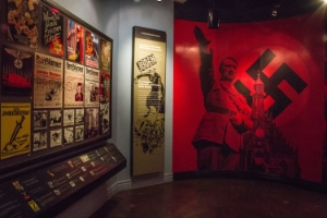 Nazi propaganda materials line the wall in one of the rooms at the El Paso Holocaust Museum.