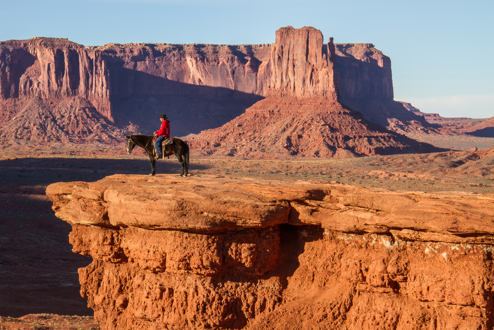 I'm glad this Navajo Indian was here while I was trying to shoot this famous cliff in Monument Valley...