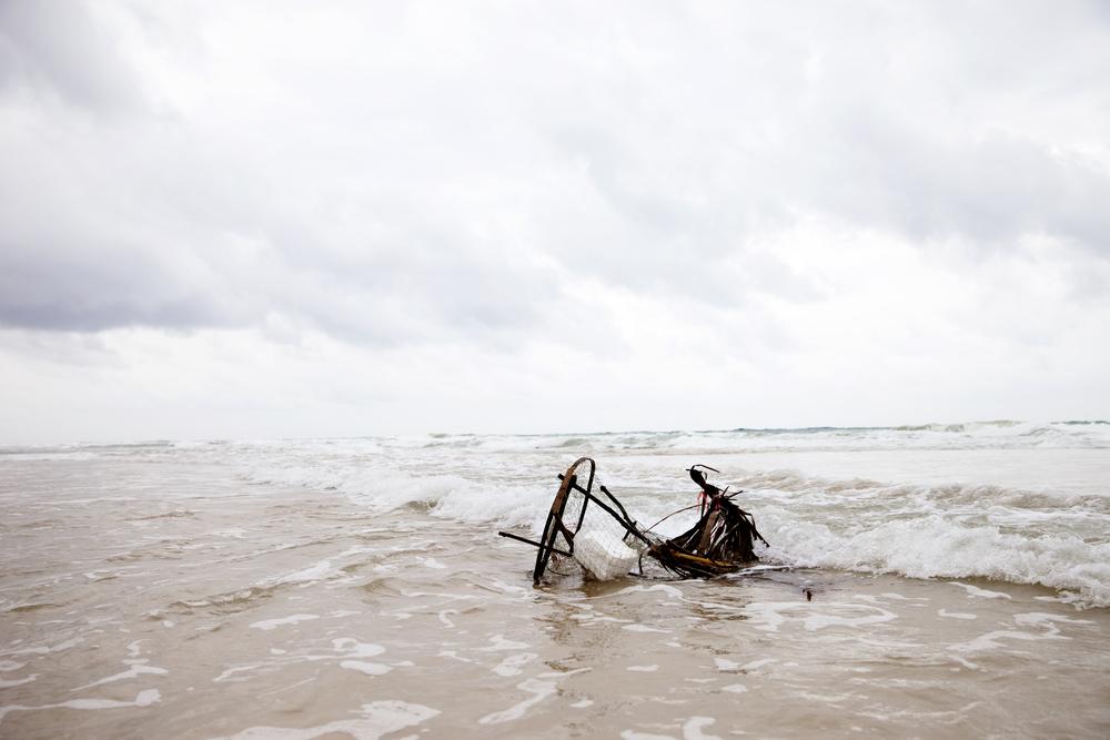 fishing trap washing into shore.