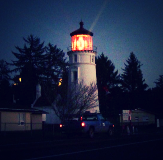 Check out the Umpqua Lighthouse located on the hill behind the dunes.