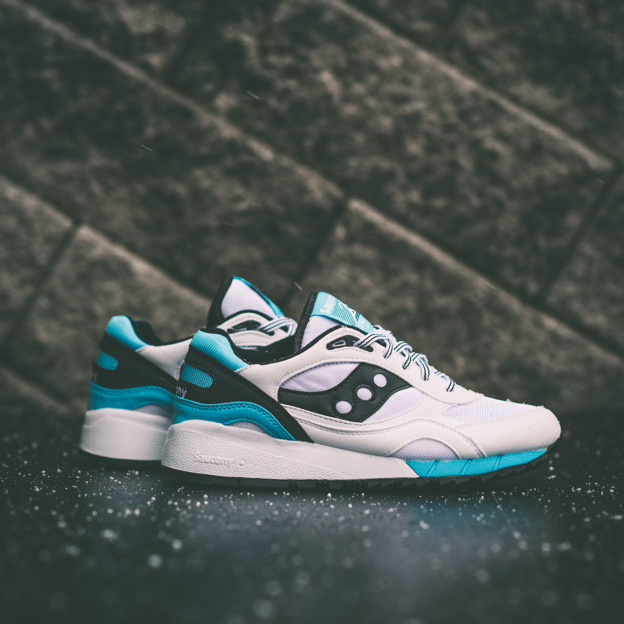 a186893e The Shadow 6000 and GRID 9000 are Saucony staples. The Shadow 6000 is an  80's classic, and this model features white as the base color with hints of  light ...