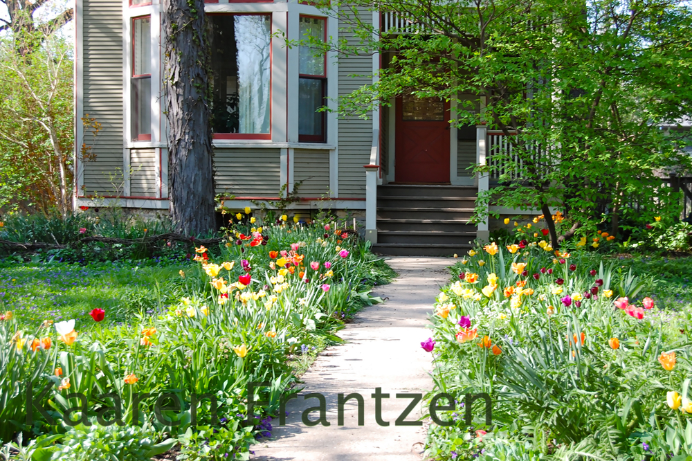Stalking this home in Oak Park with wonderful cottage style Tulip garden