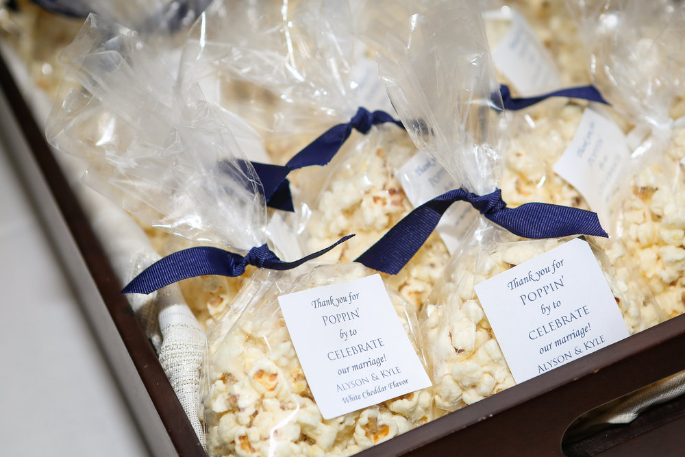 """The wedding favors were bags of popcorn available in either white cheddar or Parmesan garlic. The popcorn was from Chicagoland Popcorn and we bagged it ourselves and added cute tags that said ""Thanks for poppin' in!"""