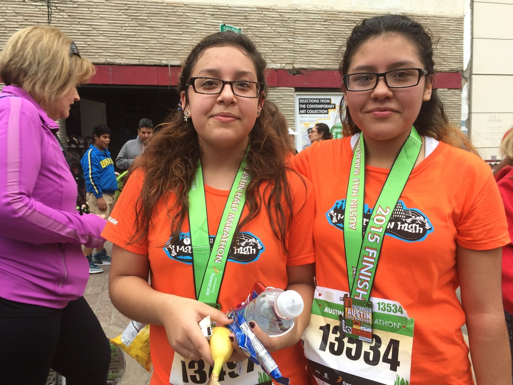 Talia (left) and her teammate at the completion of the 2015 Austin Marathon and Half Marathon.