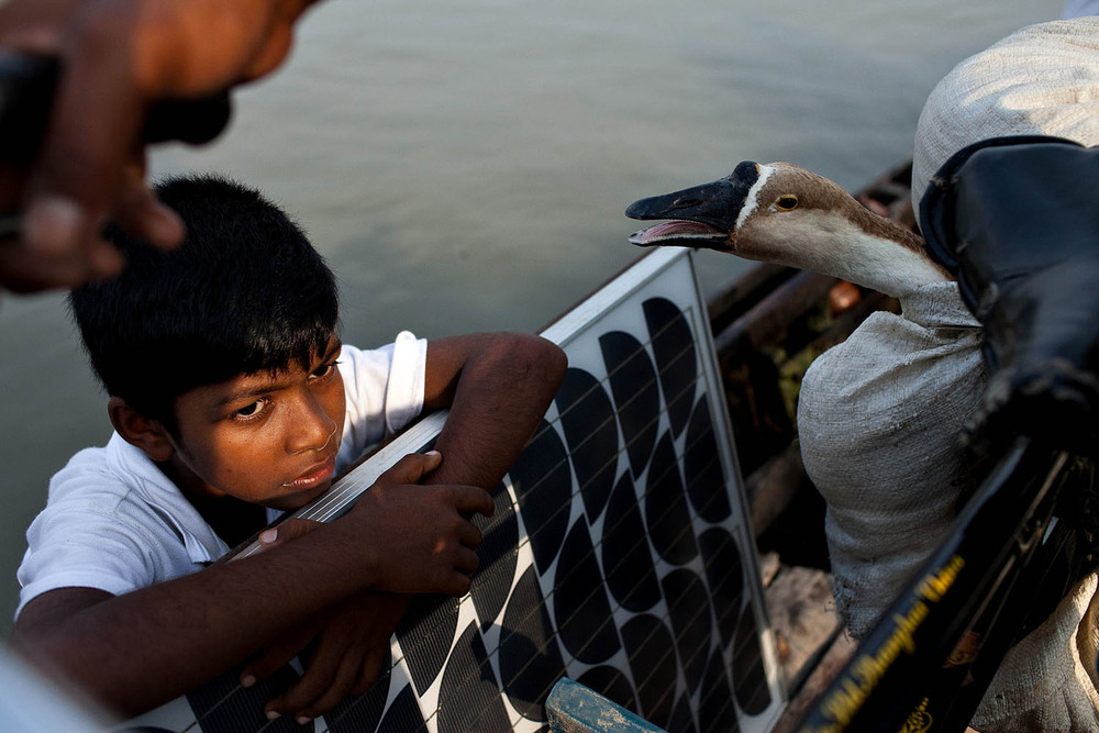Afer the hurricane Aila hit the coast of Bangladesh in 2009, thousands of people moved their homes to safer areas.