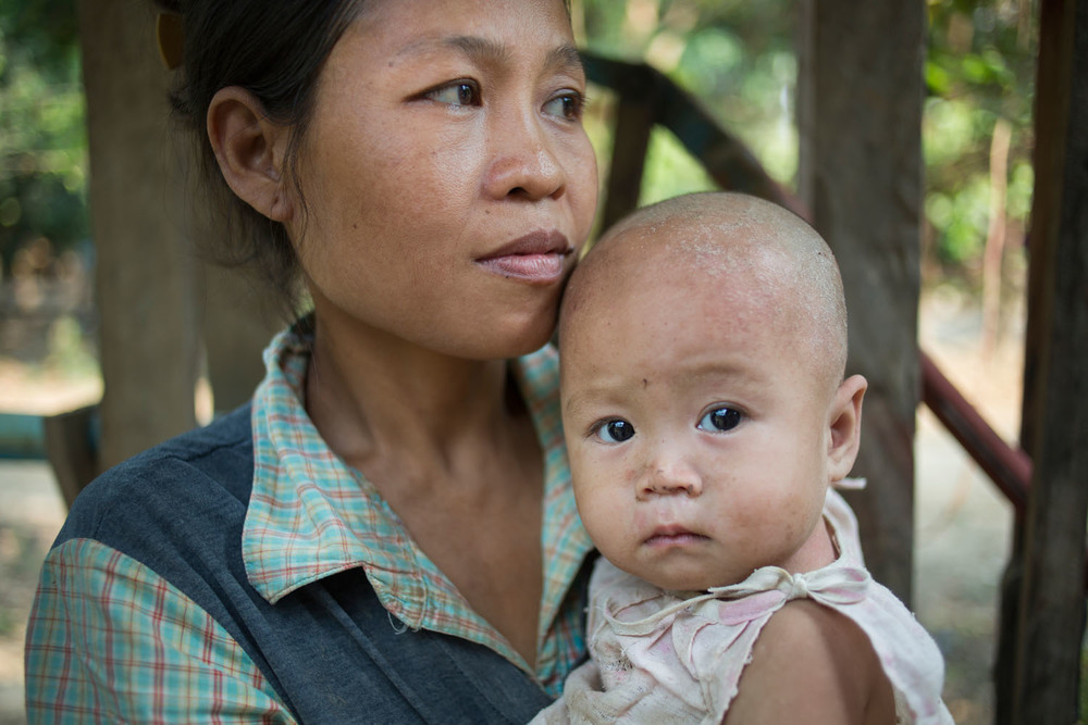 After the ceasefire agreement in 2012 Mary can travel more freely. She is still living with her husband in a relocation site, but she is going back to her village weekly to farm.  Kyaukkyi (2014).