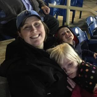 Dr. Howell enjoying the game with her family.