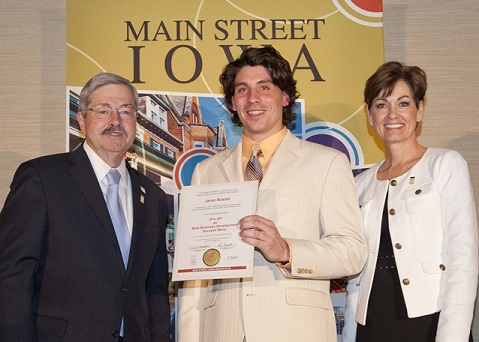 Jaron Rosien received Business  Development Success Story for JP's 207 at the 2013 Main Street Iowa  Awards from Gov. Terry Branstad and Lt. Gov. Kim Reynolds on May 17th,  2013 in Des Moines.