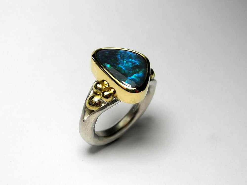Black opal set in 18ct gold with Sterling silver shank