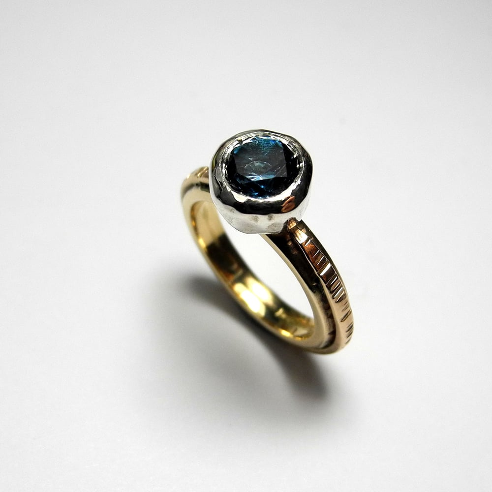 Juno ring with blue topaz, 9ct gold, and Sterling silver