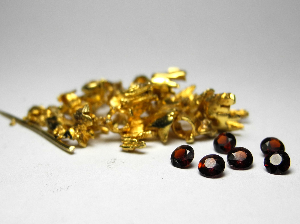 Gold and garnets recycled from an unwanted brooch