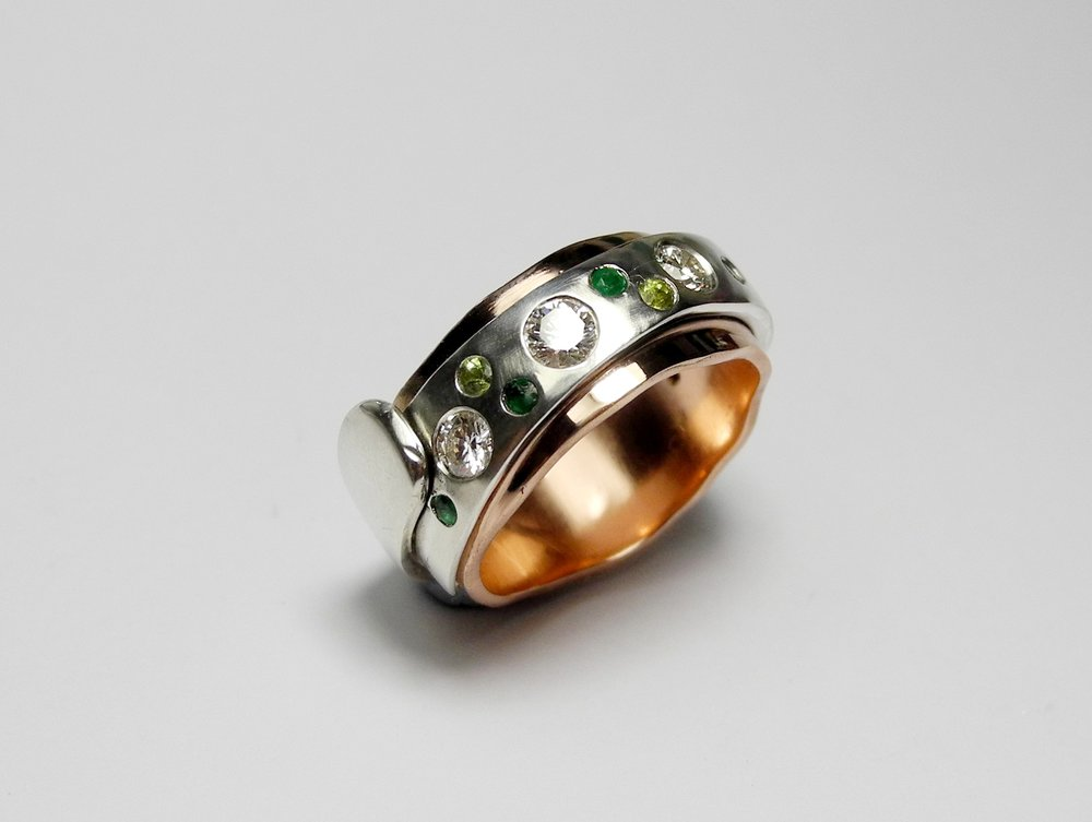 """Wrapt"" ring in Sterling silver and rose gold with diamonds, emeralds, tourmalines, and peridots"