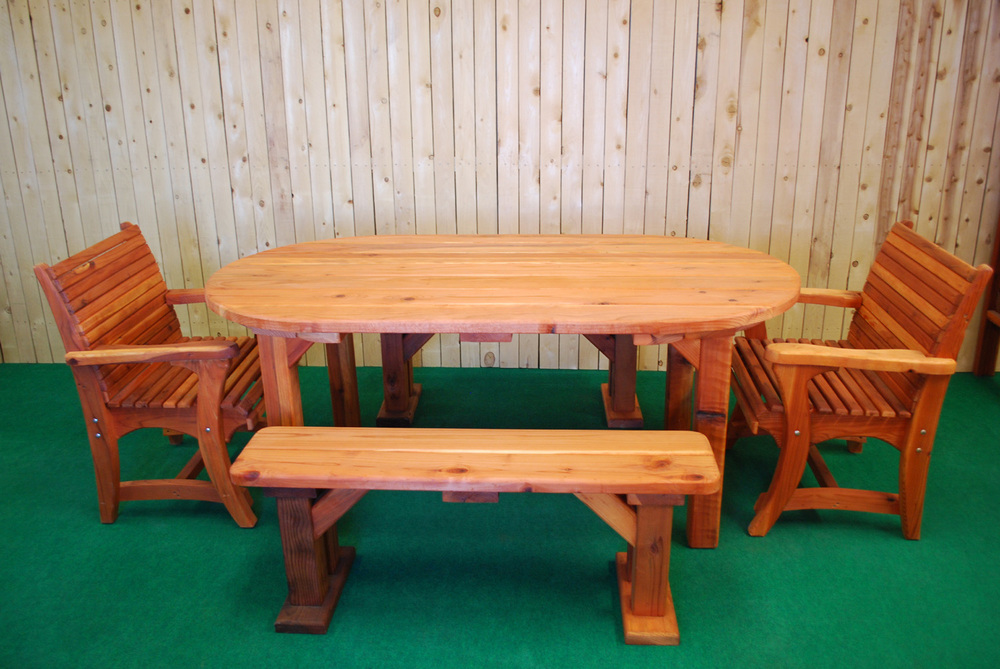 "72"" redwood oval picnic table shown with optional dining chairs"
