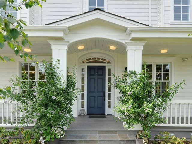 Charming New England architecture with welcoming wrap-around front porch