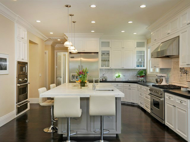 Gourmet kitchen with marble island and designer finishes throughout