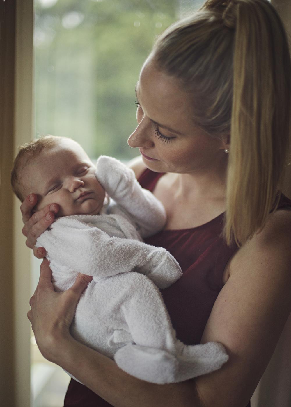 mum loves newborn baby.jpg