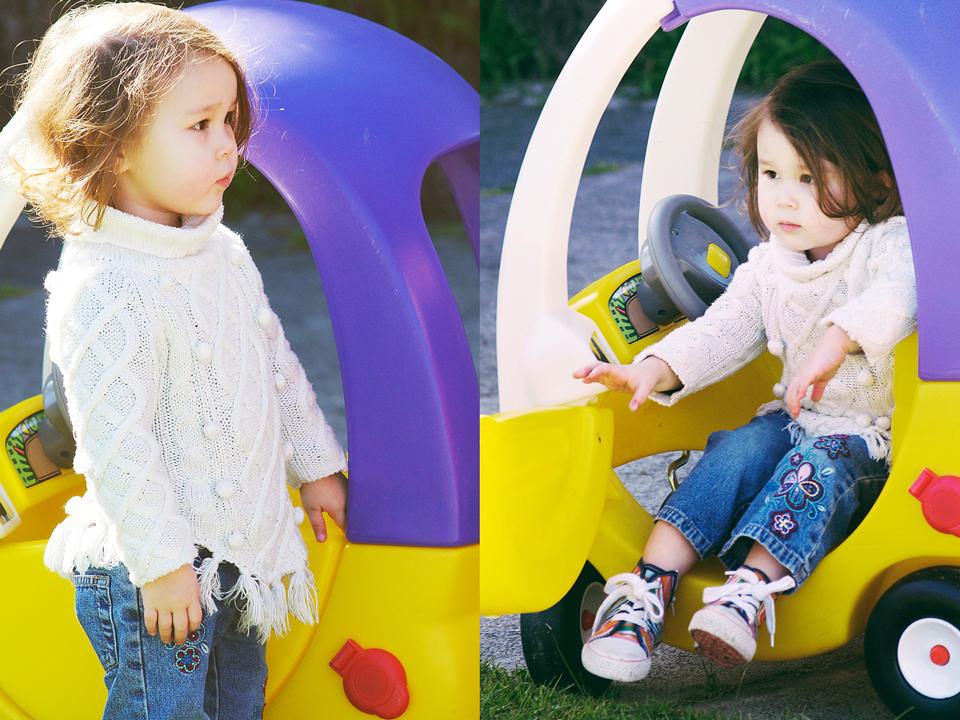 Little girl in toy car!