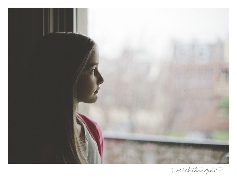 Girl looking out of window!